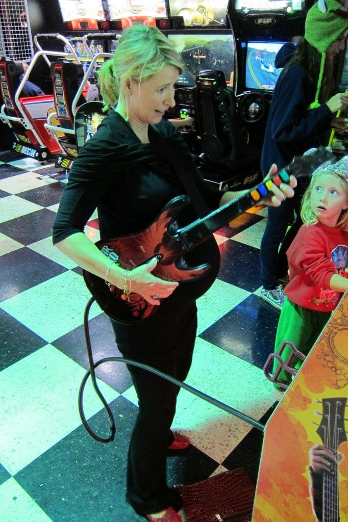 Samantha Brown playing Guitar Hero